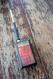 Radio transceiver. Red rectangle portable device with yellow and stock images