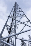 Radio transmitting tower. With snow on blue sky Royalty Free Stock Photo