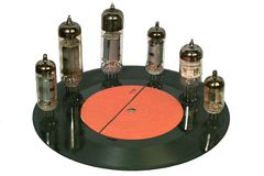 Radio tubes standing on the vinyl disc stock images