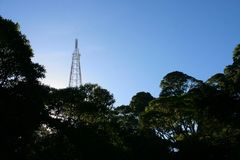 Radio and tv antenna at the top of San Salvador vulcano. View of a tall radion and tv antenna at the top of San Salvador vulcano at National Park El Boqueron stock photo