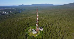 Radio TV Antenna Tower at the top of the Hill. Aerial Landscape of a Nothern Nature. Radio TV Antenna Tower at the top of the Hill. Location Kola Peninsula in stock video footage