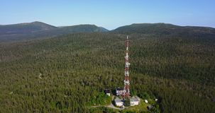 Radio TV Antenna Tower at the top of the Hill. Aerial Landscape of a Nothern Nature. Radio TV Antenna Tower at the top of the Hill. Location Kola Peninsula in stock footage