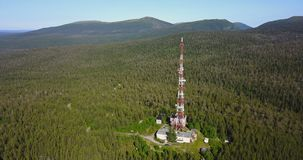 Radio TV Antenna Tower at the top of the Hill. Aerial Landscape of a Nothern Nature. Radio TV Antenna Tower at the top of the Hill. Location Kola Peninsula in stock video