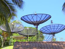Radio and TV rooftop aerials. In the tropical forest royalty free stock photos