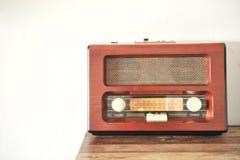 Radio vintage on white wall. Radio vintage music on white wall Royalty Free Stock Image