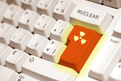 Radioactive. Button on a keyboard computer in orange Stock Photo