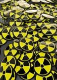 Radioactive badges. Mass of badges with radioactivity symbol Royalty Free Stock Photo