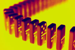 Radioactive dominoes. Standing dominoes in infrared Stock Image