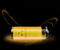 Radioactive elements. Yellow glowing radioactive material with warning sign Stock Image