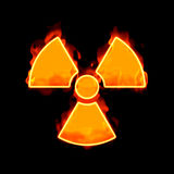 Radioactive fire. An image of a radioactive sign on fire Stock Photos