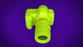 Radioactive green photo camera on purple background Stock Images