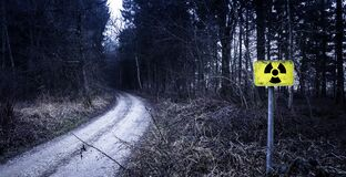 Radioactive hazard sign by forest