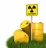 Radioactive Landfill. Barrels on grass with sign of radiation, 3d render Stock Image