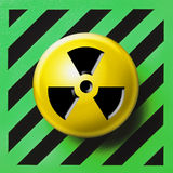 Radioactive nuclear button. Radioactive button on green and black background Royalty Free Stock Image
