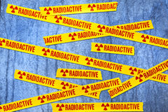 Radioactive Radiation Background. Radioactive warning tape tapped across an abstract background Royalty Free Stock Image