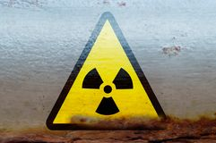 Radioactive radiation warning on the rusty container Royalty Free Stock Images
