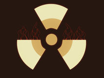 Radioactive sign with red flames Stock Images