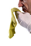 Radioactive sock. Dirty green sock on a white background Royalty Free Stock Photography