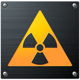 Radioactive Symbol. An engraved radioactivity symbol on a brushed metal plate Royalty Free Stock Photo