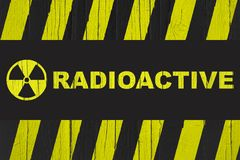 Radioactive warning sign with yellow and black stripes Stock Photo