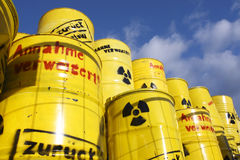 Radioactive waste. Radioactive symbols and words like back to sender imprinted on yellow barrels Royalty Free Stock Photo