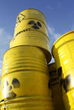 Radioactive waste. Radioactive symbol imprinted on yellow barrels with nuclear waste Stock Photos