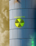 Radioactive waste in leaking containment tank. Nuclear waste tank with radioactive material cracking open with brooding storm clouds in the background royalty free stock photo