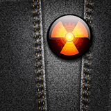 Radioactivity badge on black denim texture Royalty Free Stock Photo