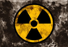 Radioactivity caution. Symbol of radioactivit and radiation on dark grunge background. Dirty rough style and scratched material of post-apocalyptic time stock photos