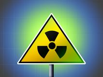 Radioactivity danger sign. On green and blue background Royalty Free Stock Photography