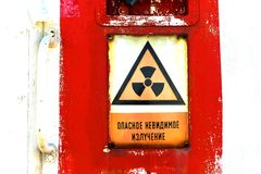 Radioactivity sign on a shelter door Stock Images