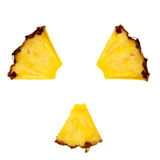 Radioactivity symbol made from pineapple segments. Stock Photos