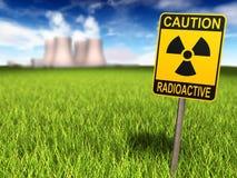 Radioaktivitäts-Zeichen und Atomkraftwerk Stockfotos
