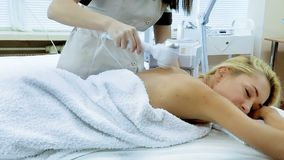 Radiofrequency treatment woman in day beauty spa salon. Radiofrequency treatment and circular motion with hand device by spa woman. Removes cellulite and body stock video