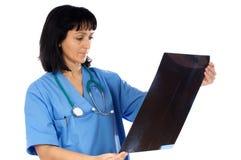 Radiografía de la pizca del doctor de la mujer Imagen de archivo
