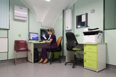 Radiographer interprets medical images Stock Photos