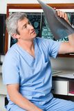 Radiologist Analyzing Patient's X-ray Stock Photography
