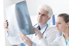 Radiologist checking an x-ray with his assistant Stock Photo