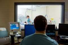Radiologist In CT Scan Lab Royalty Free Stock Photos