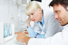 Radiologist and dentist examine panoramic radiograph Stock Images