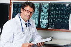 Radiologist At Desk With Clipboard Royalty Free Stock Photography