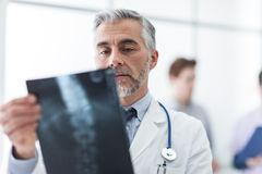 Radiologist examining a patient's x-ray Stock Photo