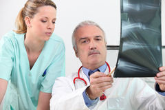 Radiologist and his assistant Stock Photos