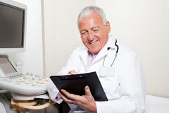 Radiologist Holding Clipboard Stock Photo
