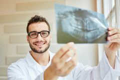 Radiologist holding x-ray Stock Photography