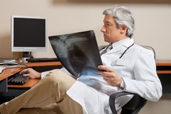 Radiologist Holding Shoulder X-ray Stock Images