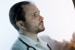 Radiologist looking at an x-ray in hospital Royalty Free Stock Images