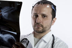 Radiologist looking at an x-ray in hospital Royalty Free Stock Image