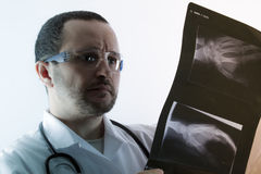 Radiologist looking at an x-ray in hospital Stock Photography