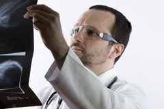 Radiologist looking at an x-ray in hospital Stock Photos